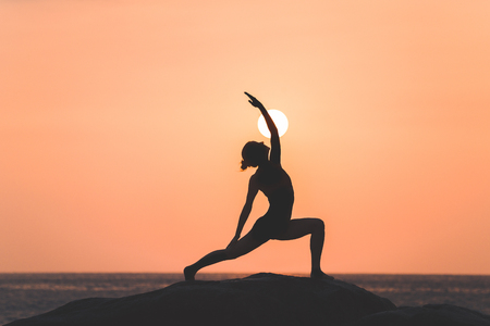 warrior girl: Warrior pose from yoga by woman silhouette on sunset