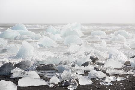ice blocks: Ice blocks on a black sand beach near Jokulsarlon lagoon, Iceland Stock Photo