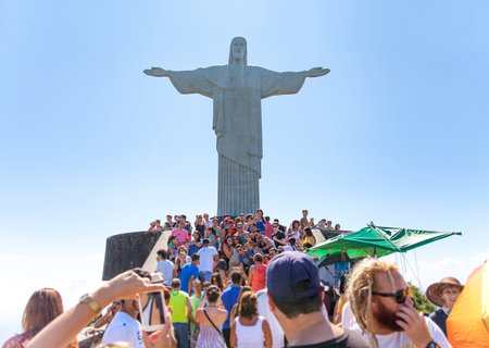 RIO DE JANEIRO, BRAZIL, DECEMBER 27, 2013: Crowd of Tourists on the Corcovado Hill visiting the Christ Redeemer created by Paul Landowski, taking shoots on their mobile phones and foto cameras.