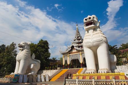 nat: MANDALAY, MYANMAR, JANUARY 8, 2015 : Gigantic Bobyoki Nat guardian statues at central entrance gate to Mandalay Hill Pagoda complex.