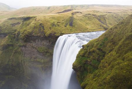 skogafoss waterfall: Skogafoss waterfall at long exposure in Iceland Stock Photo