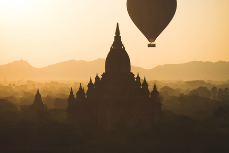 recognised: Hot air balloons fly over Bagan, that always recognised as amazing buddhism landmark.