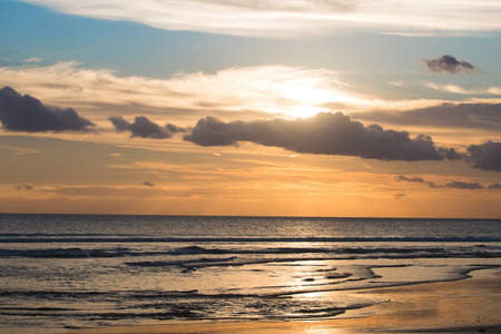 kuta: Sunset on Kuta beach in Bali, Indonesia Stock Photo