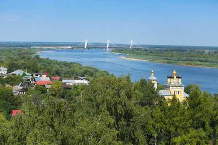 Aerial View of Russian city Murom with the church of St. Nicholas (Nikolo-Naberezhnaya) and cable-stayed bridge across Oka river.