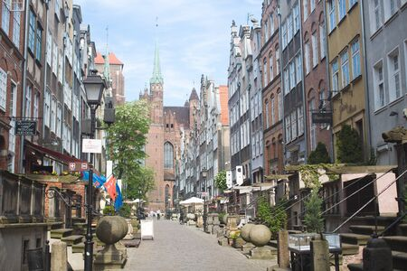 GDANSK, POLAND - MAY 31, 2016: Mariacka street nad St. Mary's church in the old town center of Gdansk, Poland Редакционное