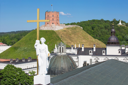 Summer view of the Gediminas Tower with the sculpture from the Cathedral of St. Stanislaus in front, Vilnius, Lithuania