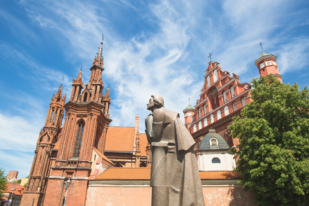 VILNIUS, LITHUANIA - MAY 27, 2016: St. Annes and Bernardinu Church in Vilnius with Polish poet Adam Mickiewicz monument in front, Lithuania Stock fotó