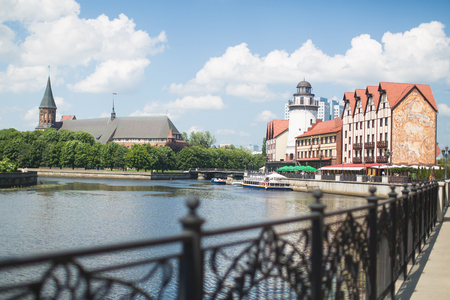KALININGRAD, RUSSIA, 30 MAY, 2016:  Cultural and ethnographic waterfront center Fishing village with cathedral on background. Stock fotó
