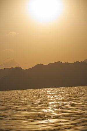 oman: Oman sunset sea mountains Stock Photo