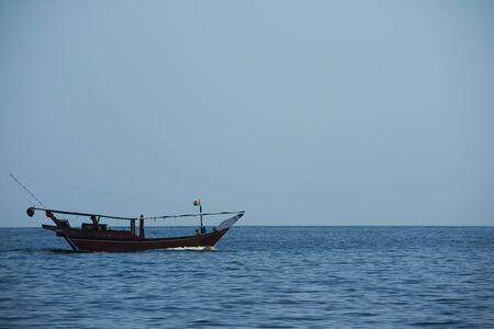 musandam: Oman boat in the sea Mountain Editorial