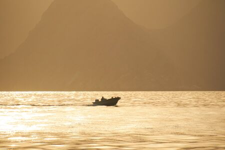 musandam: Oman boat in the sea Mountain