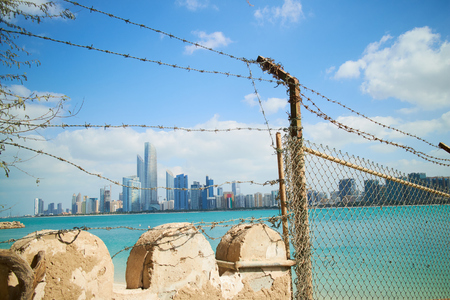 Abu Dhabi beach fence with barbed wire