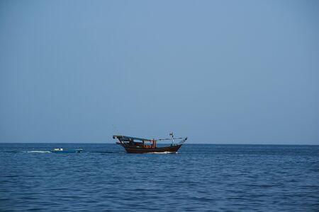 musandam: Oman boat in the sea Mountain Stock Photo