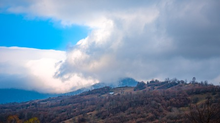snowcapped mountain: Clouds on mountains Stock Photo