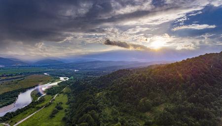 sunset in mountains, rain Stock Photo