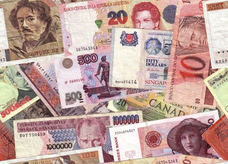 International currencies, tiled to repeat seamlessly as a background Stock Photo
