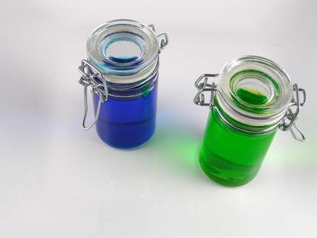 Two bottles of colored water