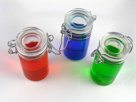Three bottles of colored water Imagens