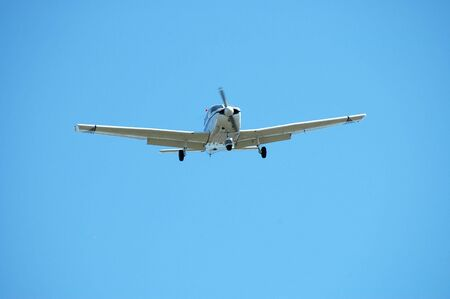 alto: Light plane landing, Palo Alto Airport, California Stock Photo