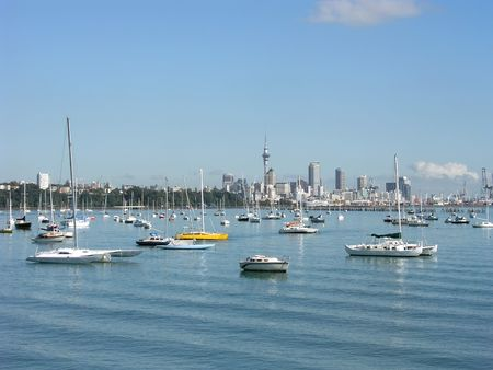 View across harbour to Auckland, New Zealand city centre photo