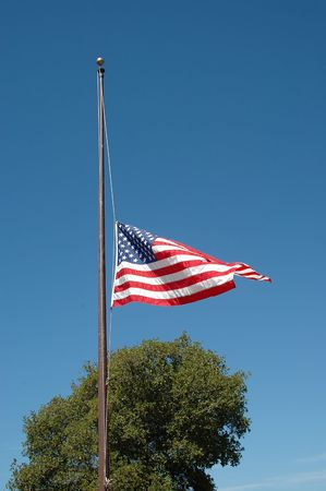 half and half: American flag at half staff
