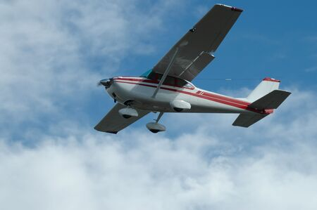 fixed wing aircraft: Light plane landing, Palo Alto Airport, California Stock Photo