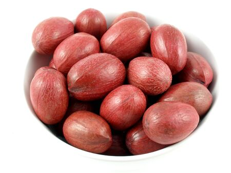 unbroken: Red shelled pecans in a bowl