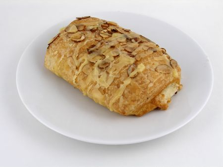 slivers: Almond croissant on a plate Stock Photo