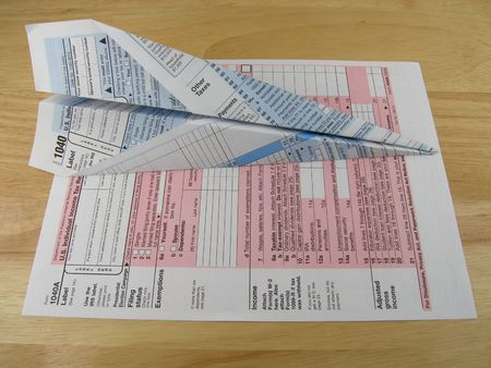 Tax form paper airplane Stock Photo