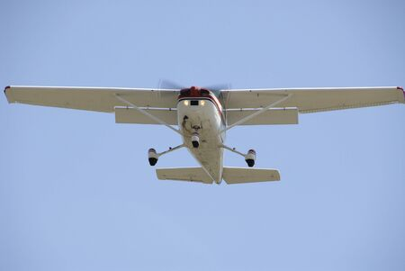 Light plane in flight, Palo Alto Airport, California photo