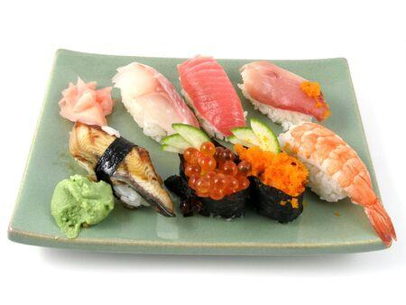 A plate of nigiri sushi Imagens