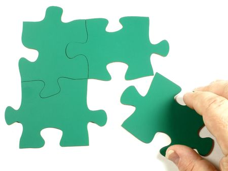 Blank jigsaw puzzle - adding a piece photo