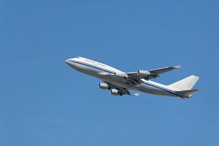 Jumbo jet ascending after takeoff photo