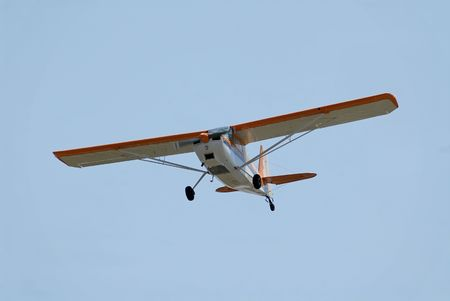 Light plane flying overhead, Palo Alto Airport, California photo