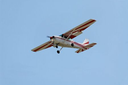 Light plane flying overhead, Palo Alto Airport, California