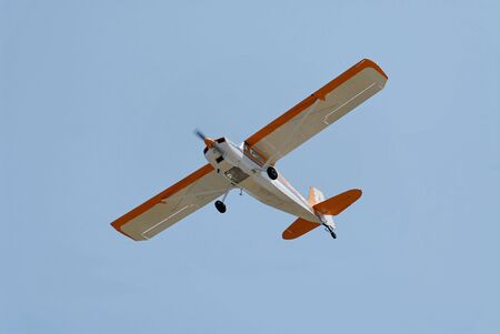 fixed wing aircraft: Light plane flying overhead, Palo Alto Airport, California