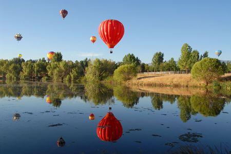 Balloons reflected in a lake, Reno, Nevada