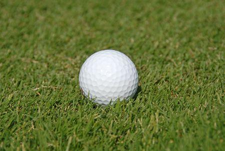 Golf ball in the grass Banco de Imagens