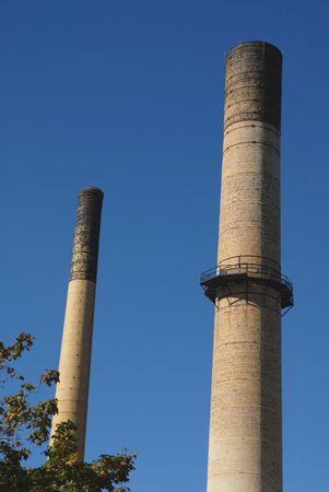 Disused brick smokestacks Фото со стока