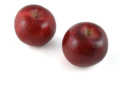 A pair of Rome Beauty apples