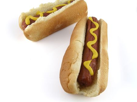 Two hot dogs on buns, with mustard