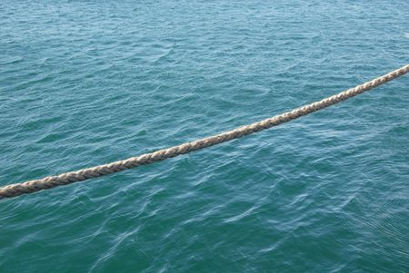 Braided rope suspended over the water