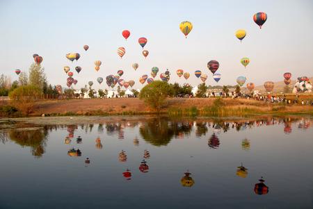 Hot air balloons reflected in a lake, Reno, Nevada