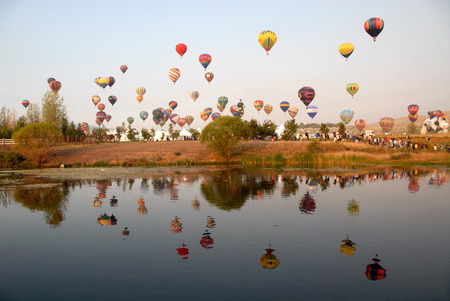 Hot air balloons reflected in a lake, Reno, Nevada