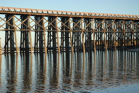 trestle: Railroad trestle reflected in the water, Fort Bragg, California