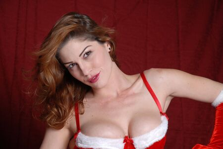 Beautiful brunette in bright red Christmas outfit