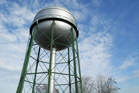 Water tower and bare trees on a winter morning, Stockton, California