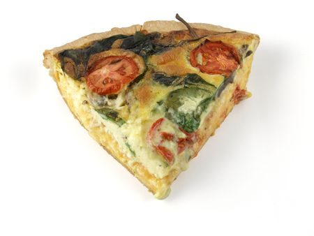 A generous slice of spinach and tomato quiche, isolated on white
