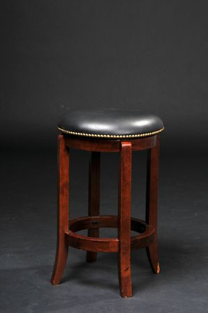 Wooden bar stool with a padded seat photo
