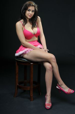 high heels woman: Beautiful young Asian woman in pink Stock Photo